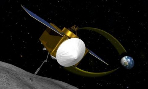 소행성 베뉴에서 로봇팔로 물질을 채취하고 있는 OSIRIS-REx의 상상도
